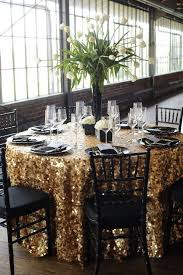 black and gold wedding ideas black table linens gold charger plates black napkins pyramid