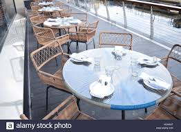 beautiful outdoor seating area of a restaurant on a bridge stock
