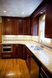 Kitchen Color Ideas With Cherry Cabinets Dark Brown Cabinets Granite Counters And Backsplash Exactly
