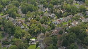 aerial luxury suburban houses in quiet modern neighborhood on