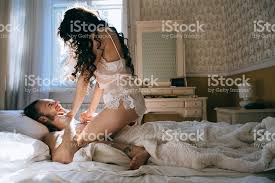 Kiss In Bed Happy Bride And Groom Embracing And Kiss In Bed Stock Photo