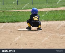 blue martini uniform age child squatting on baseball stock photo 103883012