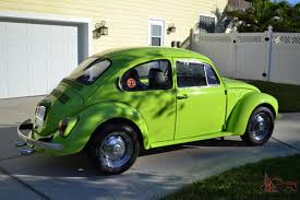 volkswagen beetle green vw beetle hippie