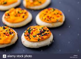 halloween sugar cookies with oranges icing and sprinkles on top