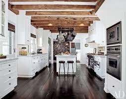 wonderful white country style kitchen with dark brown wooden