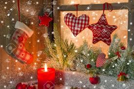 christmas decoration with red candle on window sill stock photo