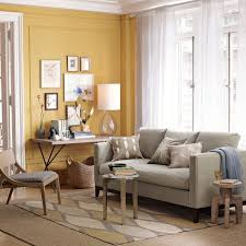 love this yellow accent wall and grey couch west elm living