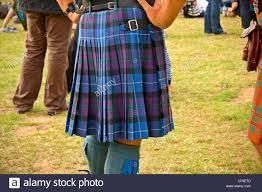 rear view of a man wearing a traditional scottish kilt stock photo