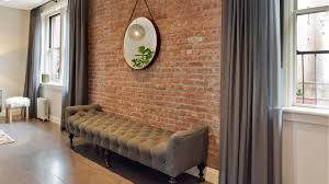 brick wall in living room carameloffers