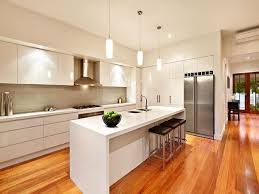 All White Kitchen Designs by I Love The Lights And Sleek Cabinet Drawers With No Handles All