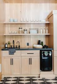 light wood kitchen pantry cabinet light oak pantry cabinets with honed black marble