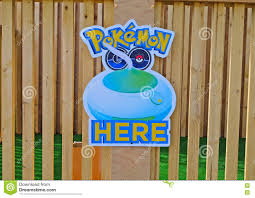the pokemon sign hanging on one of the public institutions