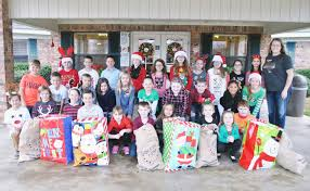 deliver presents troup students deliver presents to seniors tri county leader