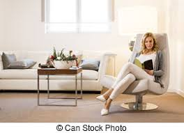 comfortable chair for reading woman sitting on chair reading book at home calm and pictures