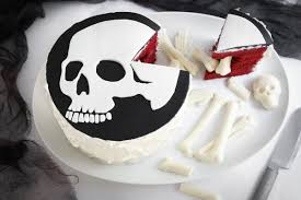throw a frightful halloween party with this skull and bones cake