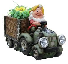 sintechno solar powered headlight of gnome truck sculpture with