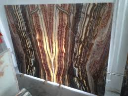 home architecture and design trends natural stone advantages archives amando natura red onyx slabs
