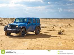 sand jeep wrangler blue jeep wrangler rubicon unlimited at desert sand dunes