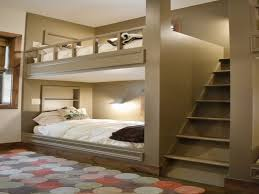 white bunk beds with stairs rack before the lovely pink wall