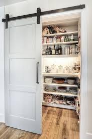 cool modern pantry design with an elegant sliding barn door