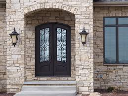 double iron door with arch top and flemish glass front doors