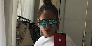 jennifer lopez shows off ripped abs in bathroom mirror selfie