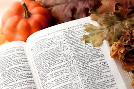 thanksgiving bible passage and fall decorations stock photos