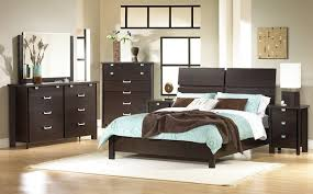 Bed Set With Drawers by Black Teak Bed Frame With Double Storage Drawers And Grey Bedding
