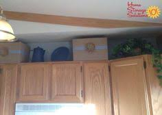 decorative items for above kitchen cabinets 10 ideas for decorating above kitchen cabinets kitchen storage