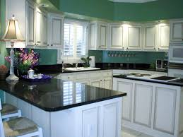 pictures of black kitchen cabinets kitchen white cabinet black granite cabin remodeling gehan homes