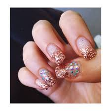 prom nail ideas with rose gold glitter and crystal gems nails