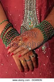 human hand asian ethnicity henna tattoo indian women bangles