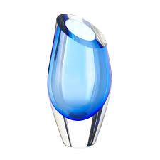 angled top blue cut glass vase