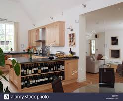 Open Plan by Open Plan Kitchen And Dining Room With Wine Shelves And View
