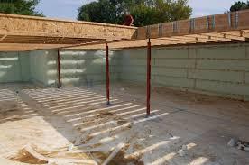 cech house basement vapor barrier and floor framing