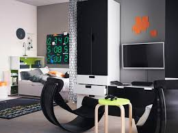 a teenage room with black white bed and storage combined with two