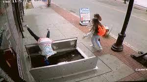 woman falls into basement trap door as she texts and walks aol