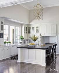 white kitchen cabinets with black quartz the many advantages of black kitchen countertops decorated