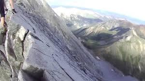 climbers walk along narrow mountain ledge jukin media