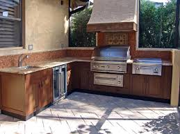 outdoor kitchen ideas wood grained powder coated stainless cabinets
