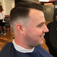 how to fade hair from one length to another this low skin fade was done with a razor about 1 3 the way up the