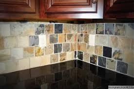 Slate Backsplash In Kitchen by Slate Backsplash Granite Tops And Beautiful Stained Cabinets