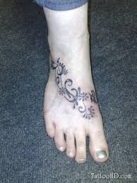 flower vine tattoo on foot and ankle