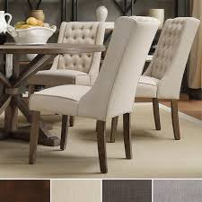 Upholstered Winged Chairs Will Give Your Dining Room An Air Of - Dining room chairs overstock