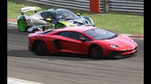 lamborghini aventador race battle mclaren p1 x lamborghini aventador sv racing at brands