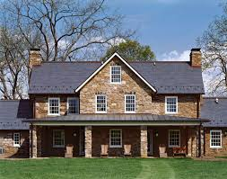 stone english carriage house dormer slate roof new construction
