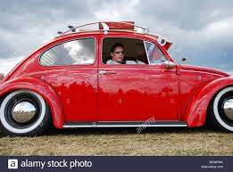 volkswagen beetle red classic red vw beetle lowrider stock photo royalty free image