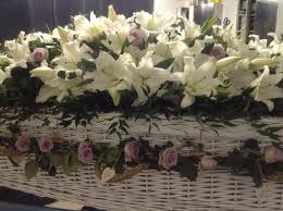 wicker casket funeral flowers white coffin spray with lilac garland