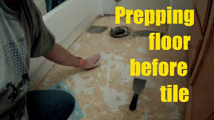 how to remove vinyl floor and tile a small bathroom diy tile