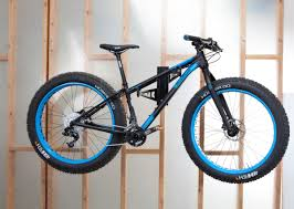 stunning wooden shelves design with mountain bike hanging as